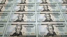 New U.S. $20 bills a printed in Washington in October of 2006. (J. SCOTT APPLEWHITE/AP)