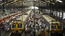 In this Feb. 11, 2013 photo, Indian commuters get off trains at the Church Gate railway station in Mumbai, India. Indian railway network is one of the world's largest, with some 14 million passengers daily and some 40,000 miles (64,000 kilometers) of railway track cut through some of the most densely populated cities. (Rafiq Maqbool/AP)