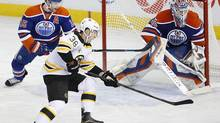 Boston Bruins Jordan Caron looks for a rebound in front of Edmonton Oilers goaltender Devan Dubnyk (40) during the first period at Rexall Place. (Perry Nelson/USA Today Sports)