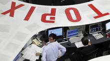 Employees of the Tokyo Stock Exchange work at the bourse in Tokyo in this March 10, 2011 file photo. (Toru Hanai/Reuters/Toru Hanai/Reuters)
