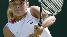 Aleksandra Wozniak of Canada hits a return to Vera Dushevina of Russia during their women's singles tennis match at the Wimbledon tennis championships in London June 26, 2012. (DYLAN MARTINEZ/REUTERS)