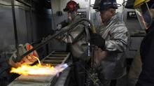 Workers cast ingots of 99.99 percent pure silver at the Krastsvetmet nonferrous metals plant in Russia's Siberian city of Krasnoyarsk. Ilya Naymushin/Reuters