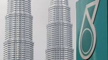 A Petronas logo is seen near its twin towers in Kuala Lumpur, Malaysia, Thursday, July 1, 2010. (Lai Seng Sin/AP)
