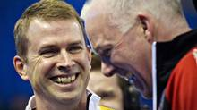 Manitoba skip Jeff Stoughton (L) and Ontario skip Glenn Howard laugh prior to their round robin match against each other at the Canadian Men's Curling Championships in Edmonton, Alberta March 3, 2013. (ANDY CLARK/REUTERS)