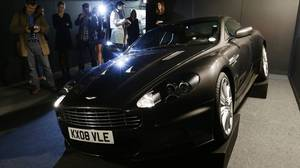 <p>The 2008 Aston Martin 6 litre V12 DBS 2 door coupe used by Daniel Craig as James Bond in the movie Quantum of Solace is shown to the media during a press preview at the James Bond movie memorabilia charity auction at Christie's auction house in London, Friday, Sept. 28, 2012. The car is expected to sell for some 100,000 -150,000 British pounds ($160-230,000 euro 120-170,00) with the proceeds going to the British children's charity Barnardo's.</p>