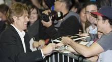 """Actor Willem Dafoe signs autographs as he arrives at the """"Antichrist"""" film gala at the Toronto International Film Festival on Sept. 11, 2009. (MARK BLINCH)"""