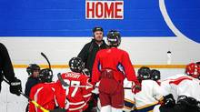 Head Coach Steve Leslie speaks with his Bantam House players during practice at Cole Harbour Place in Cole Harbour, N.S., Jan. 4, 2011. (Paul Darrow for The Globe and Mail/Paul Darrow for The Globe and Mail)