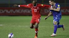 Canada's Atiba Hutchinson, left, fends off El Salvador's Pablo Punyed during a 2018 World Cup qualifying soccer match in San Salvador, El Salvador on Nov. 17, 2015. Midfielder Atiba Hutchinson has been named Canadian male soccer player of the year for the fourth time. The 32-year-old from Brampton, Ont., is leading Canada's charge in the penultimate round of World Cup qualifying while continuing to excel for Turkish club side Besiktas. (Salvador Melendez/THE ASSOCIATED PRESS)
