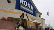 An unidentified customer walks out of a Rona store in Toronto's east end on Wednesday February 22, 2012 . (Chris Young For The Globe and Mail)