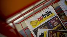 Social media postings occasionally rant about flyers ending up in dumpsters and hurting the environment, but consumers can't seem to do without the printed promotions. (Brent Lewin/Bloomberg)