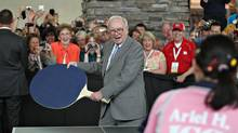 Warren Buffett, chief executive officer of Berkshire Hathaway, plays table tennis with Ariel Hsing, the number one U.S. player under twenty, on the sidelines of the Berkshire Hathaway annual meeting in Omaha, Nebraska, U.S., on Sunday, May 2, 2010. (Daniel Acker)