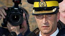 Superintendent Marty Cheliak speaks to reporters outside the RCMP detachment in Mayerthorpe, Alta., on March 4, 2005. (Jeff McIntosh/The Canadian Press)