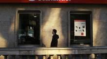 A man walks past a Santander bank branch in central Madrid December 15, 2008. (SUSANA VERA/REUTERS)
