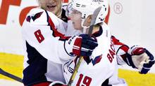 Washington Capitals' Alex Ovechkin (8) and Nicklas Backstrom (19) celebrate a goal against the Edmonton Oilers during third period NHL hockey action in Edmonton, Alta., on Thursday October 24, 2013. (JASON FRANSON/THE CANADIAN PRESS)