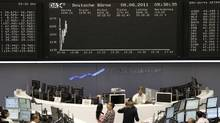 A TV crew films in front of the DAX board at the Frankfurt stock exchange on August 8, 2011. (PAWEL KOPCZYNSKI/REUTERS)
