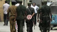 Sri Lankan solders walk in a street in Colombo, Sri Lanka, Thursday, Aug. 25, 2011. (Eranga Jayawardena/AP/Eranga Jayawardena/AP)