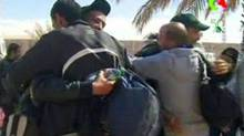 Hostages react after they were freed from a gas facility in Algeria where Islamist militants were holding them in Tigantourine, in this still image taken from video footage Jan. 18, 2013. (REUTERS TV/Reuters)