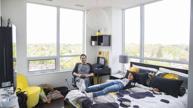 Firefighter Jason Arias and his daughter Emese Tar in their Toronto condo. A group called Options for Homes provided $42,000 for the down payment on the condo – money he doesn't have to pay back until he sells.