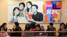 People dine at a KFC outlet in Shanghai. (ALY SONG/REUTERS)