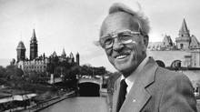 Tommy Douglas, in 1983, with the Parliament buildings in the background. (CHRIS SCHWARZ/CP)