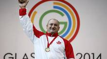 Canada's George Kobaladze celebrates after winning the gold medal in the men's +105 kg Weightlifting competition at the 2014 Commonwealth Games in Glasgow, Scotland July 31, 2014. (JIM YOUNG/REUTERS)