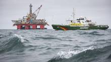 An undated handout photo shows Greenpeace ship Esperanza sailing past Transocean Spitsbergen oil rig on the Norwegian Arctic (GREENPEACE/Reuters)