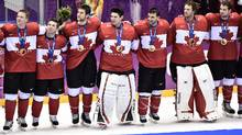 Team Canada lines up for the national anthem after winning gold at the 2014 Sochi Winter Olympics on Feb. 23, 2014. (Nathan Denette/THE CANADIAN PRESS)