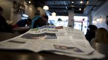 A copy of Le Devoir newspaper seen in a coffee shop in downtown Montreal, January 21, 2016. (Christinne Muschi/The Globe and Mail)