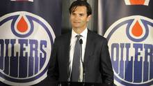 Dallas Eakins speaks during a news conference announcing his hiring as head coach of the Edmonton Oilers in Edmonton June 10, 2013. (Reuters)