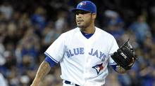 Toronto Blue Jays' closer Sergio Santos reacts after giving up a run in the ninth. (MIKE CASSESE/Mike Cassese/Reuters)