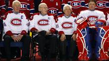 Montreal Canadiens legends (L-R) Jean Beliveau, Emile Bouchard, Elmer Lach and Patrick Roy sit together during a ceremony to celebrate the Canadiens 100th anniversary in Montreal, December 4, 2009. (SHAUN BEST)
