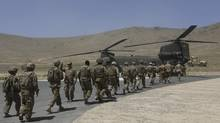 NATO soldiers board a Chinook helicopter after a security handover ceremony at a military academy outside Kabul on June 18, 2013. The U.S.-led NATO coalition has launched the final phase of the 12-year war with the last round of security transfers to Afghan forces. (OMAR SOBHANI/REUTERS)