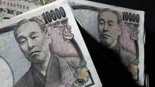 Japanese 10,000 yen bank notes are seen at an office of World Currency Shop in Tokyo. (YURIKO NAKAO/REUTERS)