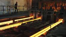 File photo of a steel factory in Hefei, China. the share prices of Asian steel producers have fallen about 30 per cent in the last year - underperforming the broader market by a fifth. (JIANAN YU/JIANAN YU/REUTERS)