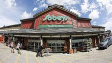 Closings of Sobeys distribution centres led Empire to record a $103-million charge in its latest quarter. (Todd Korol For The Globe and Mail)