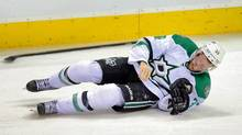 Dallas Stars defenceman Alex Goligoski lays on the ice after being hit by Winnipeg Jets forward Anthony Peluso (not shown) during the second period at MTS Centre in Winnipeg on Dec. 14. (Bruce Fedyck/USA Today Sports)