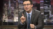 """John Oliver speaks during """"Last Week Tonight with John Oliver,"""" in New York on April 2014. THE CANADIAN PRESS/AP, HBO, Eric Liebowitz"""