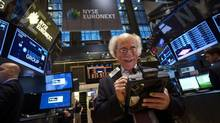 Trader Peter Tuchman smiles as he works on the floor of the New York Stock Exchange after the market opening in New York, December 23, 2013. (CARLO ALLEGRI/REUTERS)