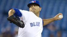 Toronto Blue Jays starting pitcher Ricky Romero throws against the Seattle Mariners in the first inning of their American League MLB baseball game in Toronto May 3, 2013. (FRED THORNHILL/REUTERS)