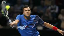 Jo-Wilfried Tsonga of France plays a return to Mardy Fish of the U.S. during their round robin singles match at the ATP World Tour Finals. (Alastair Grant/Assocaited Press)