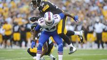 Pittsburgh Steelers outside linebacker Ryan Shazier (50) hits Buffalo Bills wide receiver Sammy Watkins (14) in the first quarter of an NFL football preseason game on Aug. 16 in Pittsburgh. (Vincent Pugliese/AP)