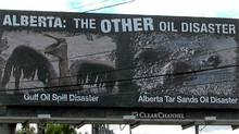 A Seattle billboard urges would-be vistors to Alberta to rethink their plans. (The Canadian Press)