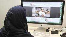 A Saudi woman watches a Youtube video of Omar Hussein In Jeddah March 26, 2012. The media is censored and reporters who cross unofficial red lines can face the sack, hefty fines or even prison sentences. But bloggers and contributors to online forums now openly discuss social ills, government inefficiency and corruption, while a Twitter user who ridicules the royal family has attracted 250,000 followers. (STRINGER/REUTERS)