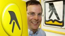 Marc Tellier, chief executive of Yellow Media Inc., formerly Yellow Pages, shows the company's new logo (Ryan Remiorz)