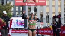 Lanni Marchant sets a new Canadian women's record at 2:27:59 as she crosses the finish line taking third place in the women's full marathon at the Scotiabank Toronto Waterfront Marathon in Toronto on Oct. 20, 2013. (Michelle Siu For The Globe and Mail)