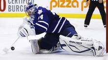 Toronto Maple Leafs goalie James Reimer makes a save against the New Jersey Devils during the third period of their NHL game in Toronto, March 4, 2013. (MARK BLINCH/REUTERS)