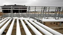 Oil pipelines feed into storage tanks at the Enbridge Cushing Terminal in Oklahoma. (SHANE BEVEL/BLOOMBERG NEWS/SHANE BEVEL/BLOOMBERG NEWS)
