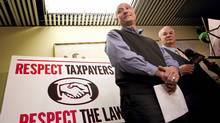 Clayton Ruby, with his client, Paul Magder, left, give details for a civil lawsuit against Toronto Mayor Rob Ford during a media briefing on Monday. (Peter Power/The Globe and Mail/Peter Power/The Globe and Mail)
