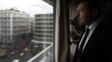 Greece's Finance Minister Yannis Stournaras looks through his office window in Athens June 2, 2014. (Alkis Konstantinidis for The Globe and Mail)