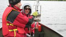 Andrew Paterson, left, and Chris Jones collect sediment cores in the Hudson Bay Lowlands. (MIKE VEILLEUX)